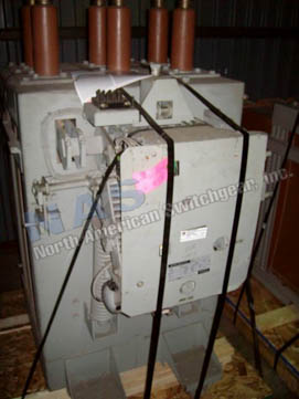General Electric AM13.8-750-6F Magne Blast circuit breaker pictured.